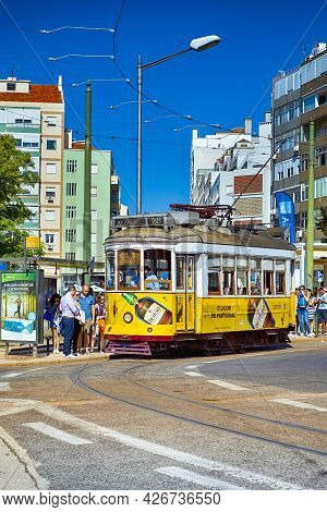 Lisbon, Portugal- October 22, 2018: Traditional Lisbon Yellow Tram On Street Of Alfama District In P