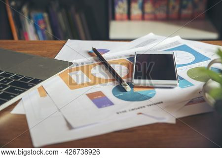 Home Office Desk Concept.laptop And Smartphone For Accountant Or Bookkeeper Plan Annual Budget And T