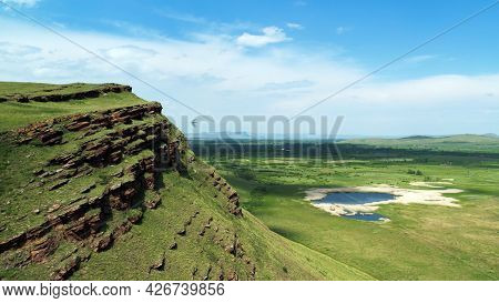 Hills And Mountains Against The Sky, A Beautiful Landscape. Chests Mountain Range In Khakassia