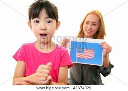 Girl studying in English with teacher