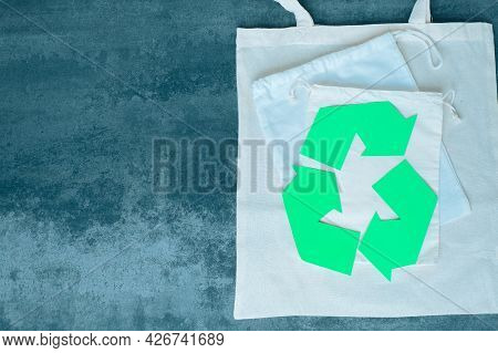 Recycling Sign And Eco Bags. Eco Friendly And Reusable Packaging. High Quality Photo