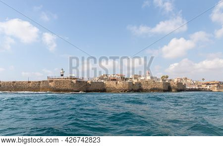 Acre, Israel, June 26, 2021 : View From The Boat To The Mediterranean Sea, The Fortress Wall And Bui