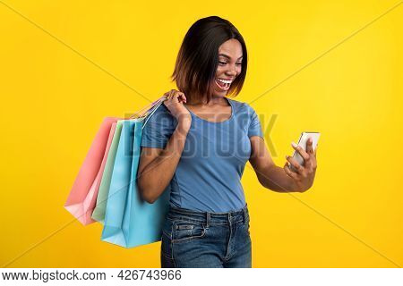 Excited Black Lady Making Selfie Posing With Shopper Bags, Studio