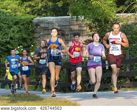 North Babylon, New York, Usa - 8 July 2019: Fast Runners Crossing The Bridge Racing A 5k At Belmont