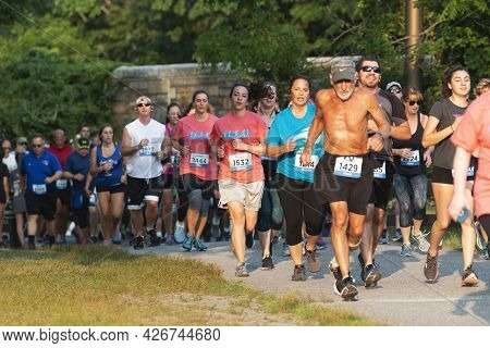 North Babylon, New York, Usa - 8 July 2019: Runners Racing A 5k At Belmont Lake State Park On A Path