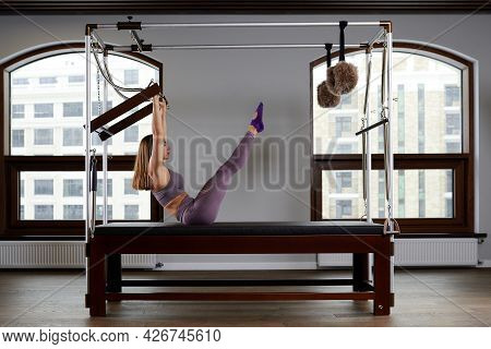 Modern Equipment Cadilac Reformer For Pilates In The Gym, Concept Of Health And Rehabilitation, Inst