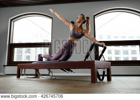 Modern Equipment Studio Reformer For Pilates In The Gym, Concept Of Recovery And Rehabilitation, The
