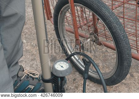 Pumping Air Into Carriage Wheel. The Air Pumping System In The Wheel. Nipple On The Wheel