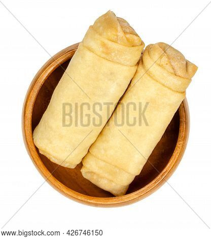Unfried Spring Rolls, In A Wooden Bowl. Two Spring Rolls, Ready To Fry. Filled And Rolled Wrappers,