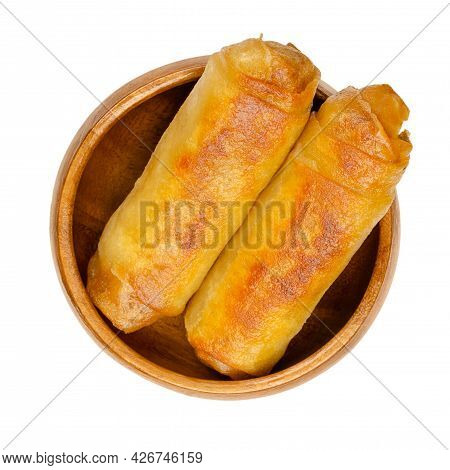 Fried Spring Rolls, In A Wooden Bowl. Two Spring Rolls, Crispy Fried In A Pan. Filled And Rolled Wra