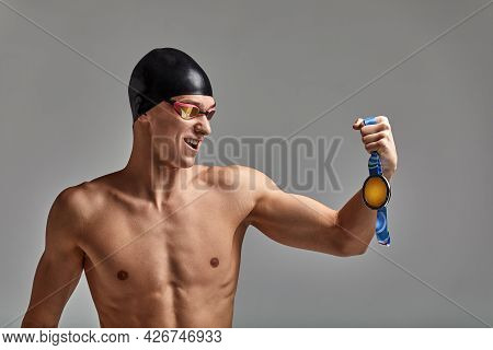 Joyful Athlete Swimmer With A Medal In His Hands Positive Emotions, Joy Of Victory, The Concept Of S