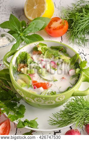 Summer Cold Raw Food Soup, Okroshka In Bowl On White Wooden Background With Ingredients
