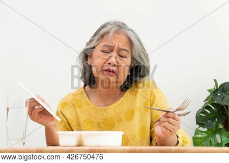 Unhappy Asian Senior Woman Anorexia And Say No To Ready Meals, Elderly Home Alone And Bored Food And