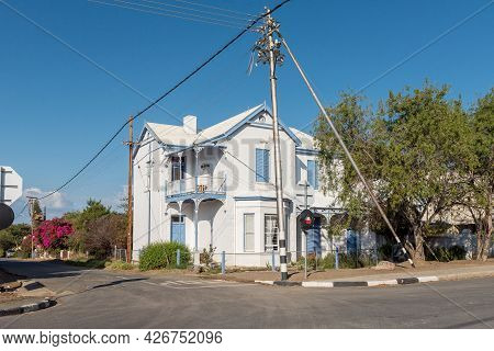Prince Albert, South Africa - April 20, 2021: A Street Scene, With A Double Storey Guest House, In P