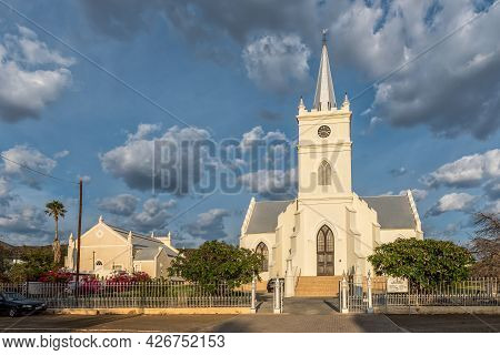 Prince Albert, South Africa - April 21, 2021: An Early Morning Street Scene, With The Dutch Reformed