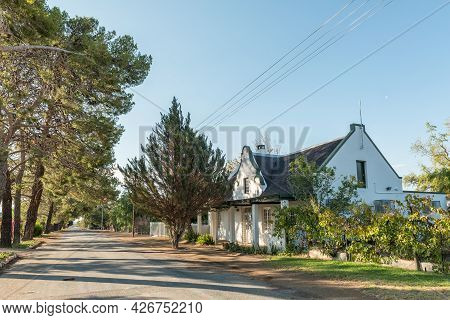 Prince Albert, South Africa - April 20, 2021: A Late Afternoon Street Scene, With A Cape-dutch House