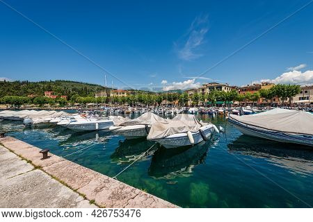 Port Of The Small Town Of Garda With Many Boats Moored, Tourist Resort On The Coast Of Lake Garda (l