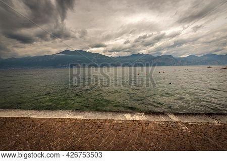 Lago Di Garda. The Lake Garda View From The Port Of The Small Village Of Castelletto Di Brenzone, Br