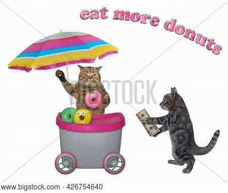 A Gray Cat Buys A Doughnut In A Grey Movable Kiosk. White Background. Isolated.