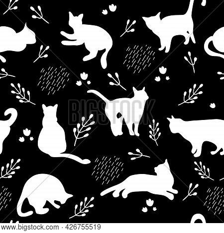 Seamless Pattern With White Cats Silhouettes On Black Background. Cute Kittens.feline In Different P