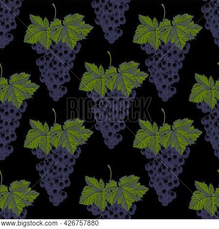 Seamless pattern of grapes on a black background. A bunch of grapes with leaves.