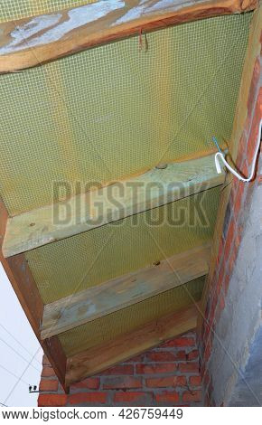 Roofing Construction. A View Of The Underside Of An Unfinished Roof, Attic With A Vapor Membrane And