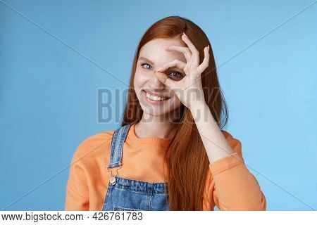 Girl Search Perfection. Charming Pretty Glad Redhead Female Student Assuring Everything Ok Showing O