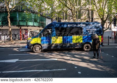London - May 29, 2021: Police Territorial Support Group Van On A Pedestrian Crossing On A London Str