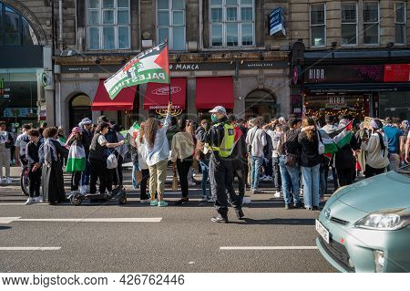 London - May 29, 2021: British Police Officer Wearing A Ppe Face Mask At A Freedom For Palestine Pro