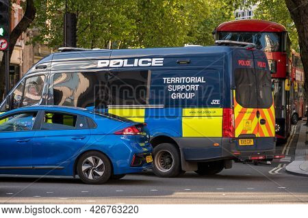 London - May 29, 2021: A Police Territorial Support Group Van In Traffic On A London Street