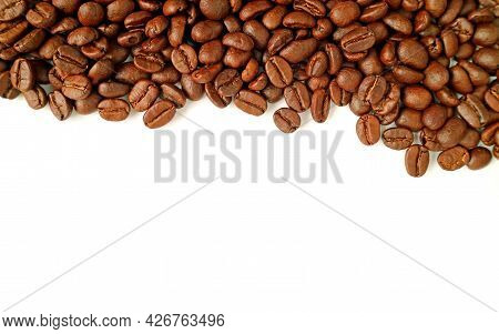 Heap Of Roasted Coffee Beans Isolated On White Background With Copy Space