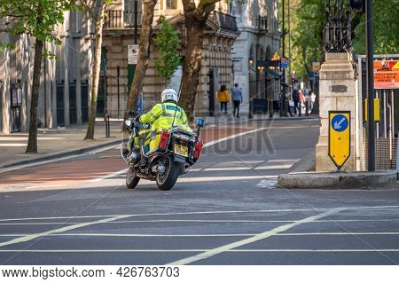 London - May 29, 2021: British Police Motorcyclist On The Streets Of London