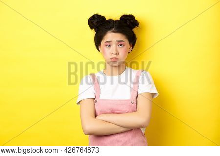 Sad Asian Teen Girl Sulking, Cross Arms On Chest, Pouting And Frowning, Complaining On Unfair Thing,