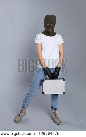 Woman Wearing Knitted Balaclava With Metal Briefcase On Grey Background