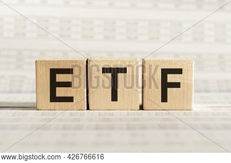 Etf Abbreviation - Exchange Traded Fund, On Wooden Cubes On A Light Background.
