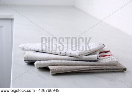 Stack Of Soft Kitchen Towels On Countertop Indoors