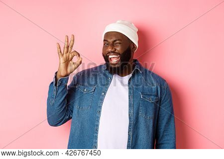 Happy Smiling African American Man Showing Okay Sign, Approve And Praise Good Offer, Standing Over P