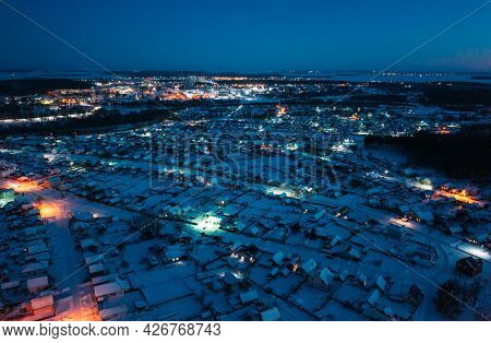 Aerial View Of Town Skyline Winter Night. Snowy Landscape Cityscape Skyline.