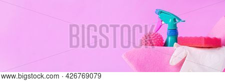Cleaning Set On Pink. Spray Bottle, Laundry Ball, Sponge, Rag And Latex Gloves. Web Banner With Copy