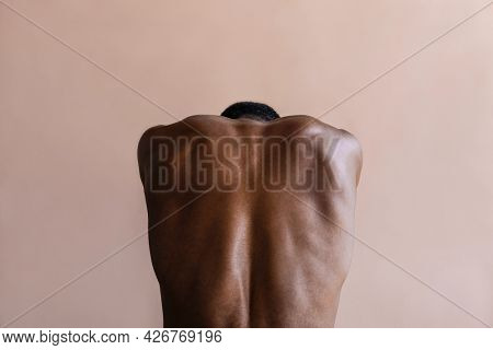 Rear view of a flexed back muscular
