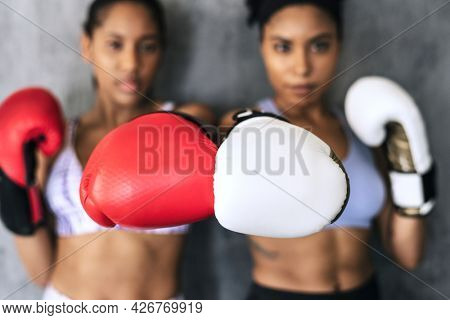 Muscular sportive women ready to box