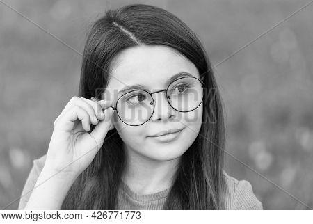 Little Girl Wear Vintage Rim Eyeglasses Green Lawn Background, Fashionable Accessory Concept