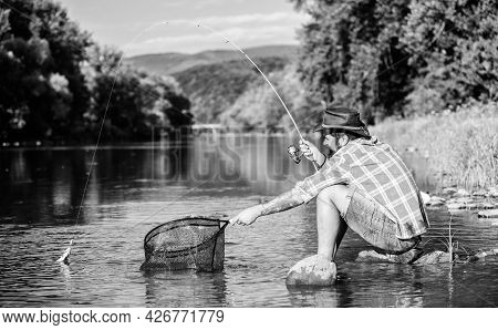 Making Me Happy. Mature Bearded Man With Fish On Rod. Successful Fisherman In Lake Water. Hipster Fi