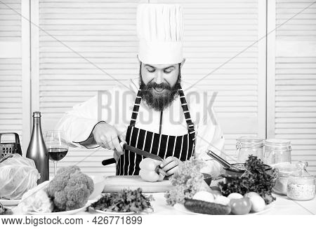 Man Master Chef Or Amateur Cooking Food. Sharp Knife Chopping Vegetable. According To Recipe. Prepar