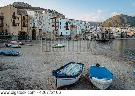 Beautiful Old Harbor With Wooden Fishing Boats,colorful Waterfront Stone Houses And Sandy Beach In C