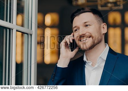 Mobile Call. Handsome Male Executive Manager With Bristle Has Telephone Conversation Enjoys Modern C