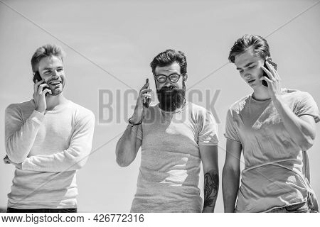 Mobile Phone Conversation. Friends Chatting Sky Background. Mobile Communication. People With Smartp