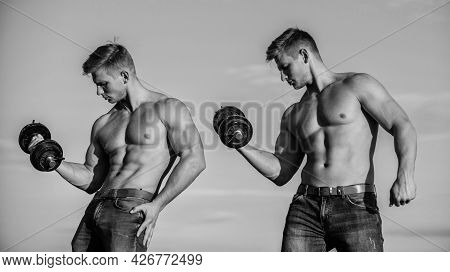 Developing Muscular Strength And Power. Strong And Fit Men Bodybuilders. Twins Muscular Men. Athleti