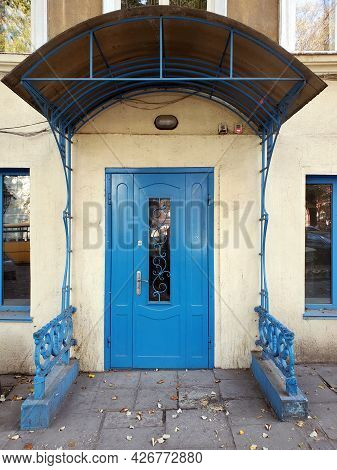 Porch And Front Door Painted In Bright Blue Color. Vintage Doorway Of Building Exterior. Classical A
