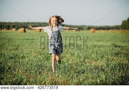 Joyful Girl Runs Through The Field, The Joy Of Meeting